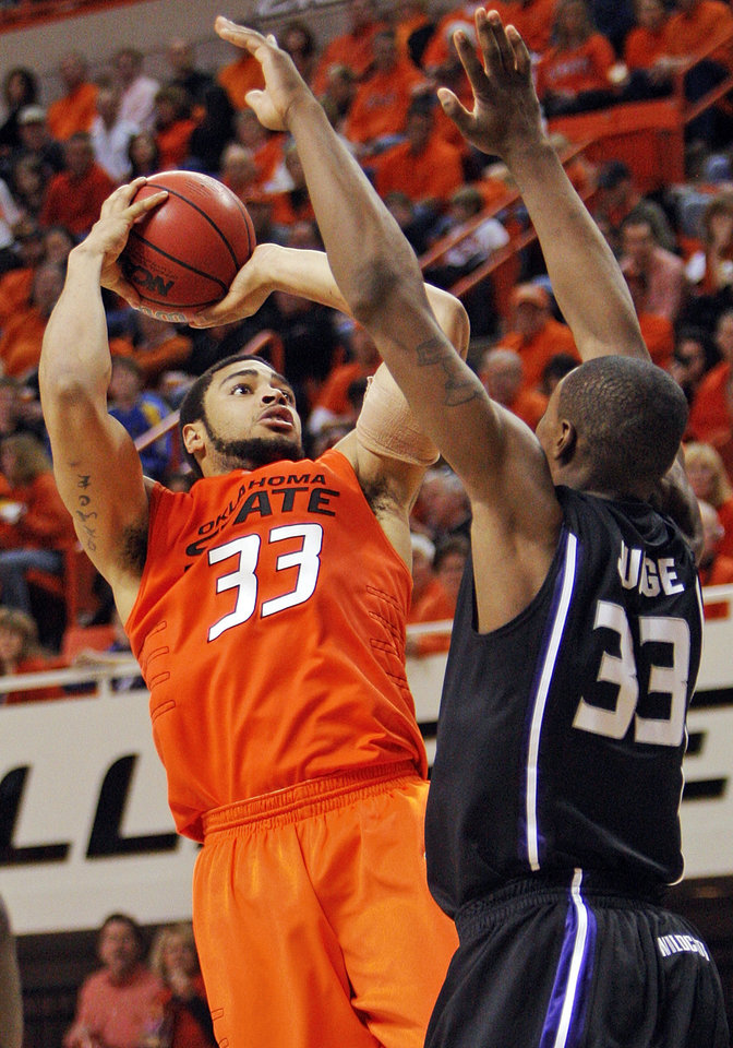 Photo - OSU's Marshall Moses (33) shoots over the defense of KSU's Wally Judge (33) during the men's college basketball game between Oklahoma State University (OSU) and Kansas State University (KSU) at Gallagher-Iba Arena in Stillwater, Okla., Saturday, January 8, 2011. OSU won, 76-62. Photo by Nate Billings, The Oklahoman