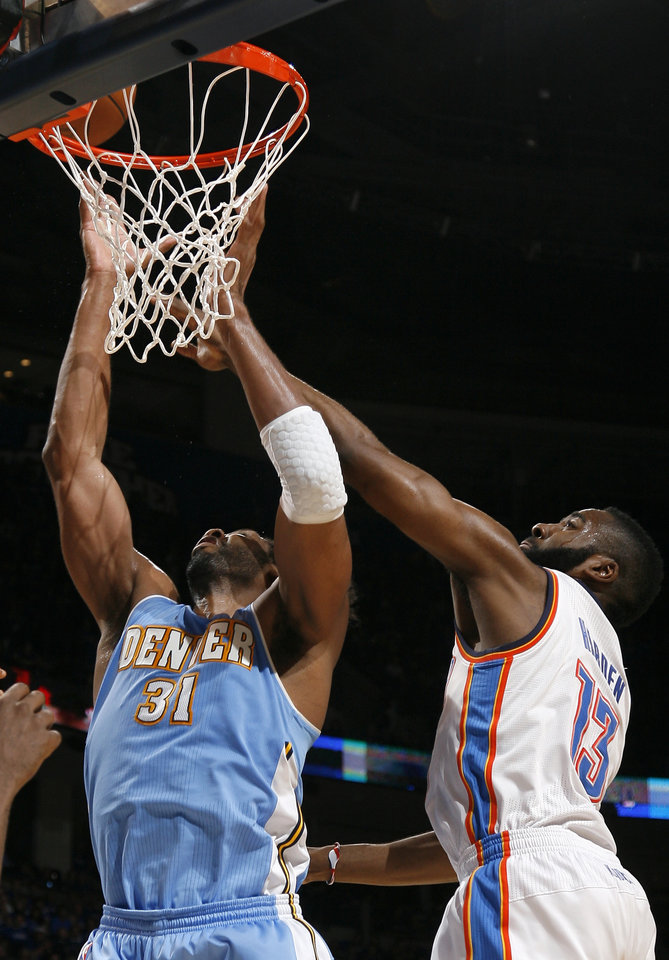 Photo - Oklahoma City's James Harden (13) defends against Denver's Nene (31)during the first round NBA basketball playoff game between the Oklahoma City Thunder and the Denver Nuggets on Wednesday, April 20, 2011, at the Oklahoma City Arena. Photo by Sarah Phipps, The Oklahoman