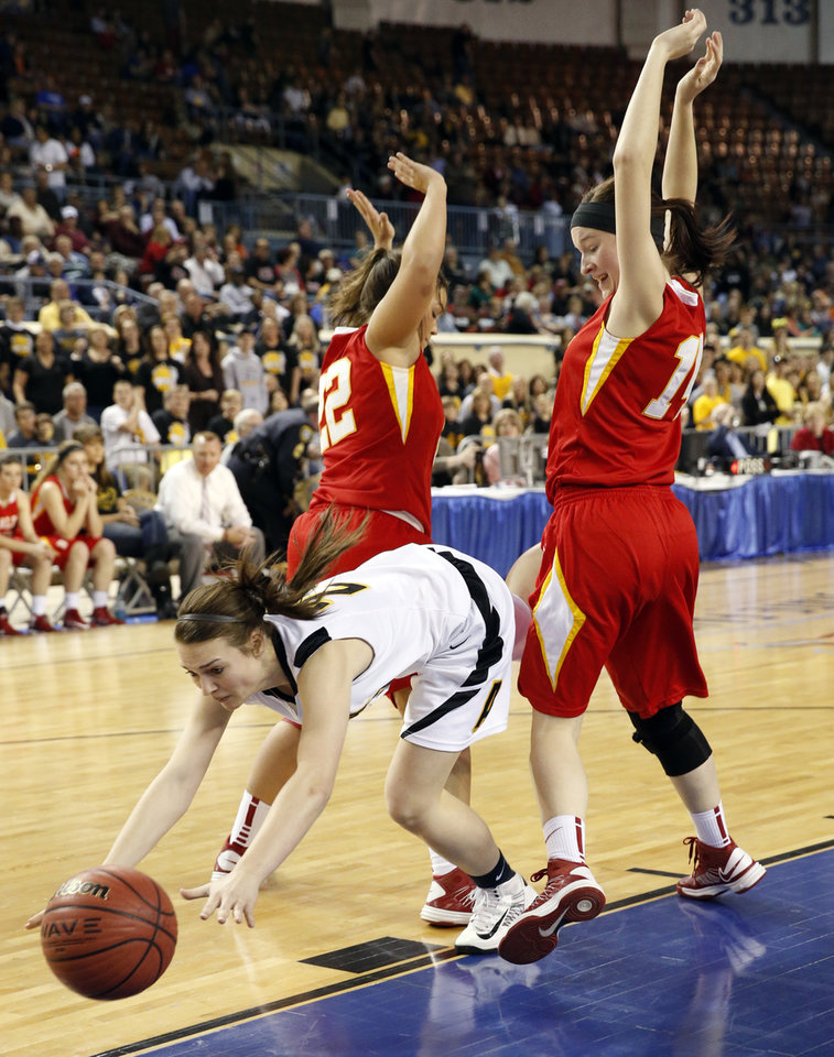 Alva\'s Jaden Hobbs hits the deck trying to split defenders Lexes Satterwhite, left, and Brayden Newton during the 2A girls semifinal game between the Dale High School Lady Pirates and the Alva Lady Bugs at the State Fair Arena on Friday, March 8, 2013 in Oklahoma City, Okla. Photo by Steve Sisney, The Oklahoman