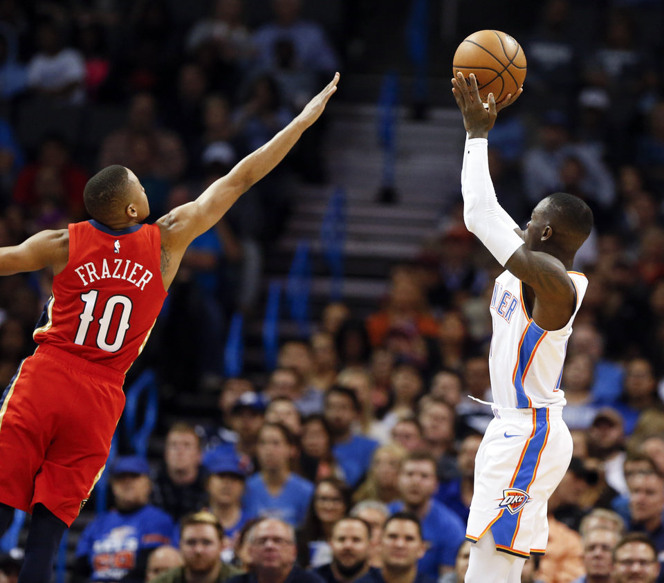 Photo - Oklahoma City's Dennis Schroder (17) shoots against New Orleans' Tim Frazier (10) during an NBA basketball game between the Oklahoma City Thunder and the New Orleans Pelicans at Chesapeake Energy Arena in Oklahoma City, Monday, Nov. 5, 2018. Oklahoma City won 122-116. Photo by Nate Billings, The Oklahoman