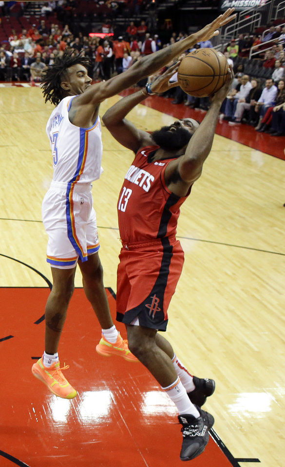 Photo - Houston Rockets guard James Harden, right, shoots as Oklahoma City Thunder guard Terrance Ferguson defends during the first half of an NBA basketball game, Monday, Oct. 28, 2019, in Houston. (AP Photo/Eric Christian Smith)