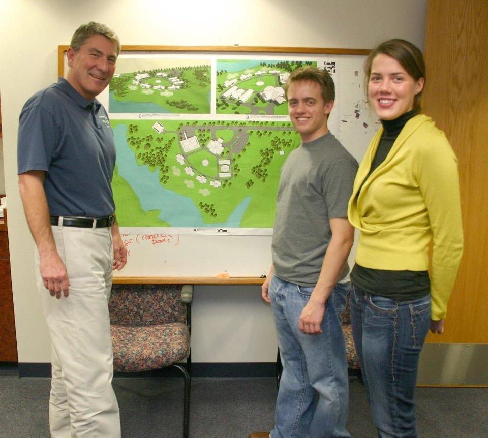 Uwe von Schamann (left), director of development for the J. D. McCarty Center, shows plans for the layout of Camp ClapHans to Heath Thompson and Amy Herritt. Thompson, a junior energy management major from Ada, and Herritt, a junior marketing major from Oklahoma City, had just presented a check to von Schamann for $13,895 that will be invested into Camp ClapHans summer camp scholarship endowment fund. Thompson and Herritt were members of OU's Price College of Business Integrated Business Core class that sets up student companies that market products and support a non-profit agency with the profits during the semester long course.<br/><b>Community Photo By:</b> Greg Gaston<br/><b>Submitted By:</b> Greg, Norman