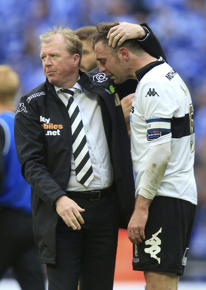 Photo - Derby County manager Steve McClaren, left,  consoles his palayer Richard Keogh after the English Championship Play Off Final against Queens Park Rangers at Wembley Stadium, London Saturday May 24, 2014. QPR won the match and gained promotion to the English Premier League next season. (AP Photo/Mike Egerton/PA) UNITED KINGDOM OUT