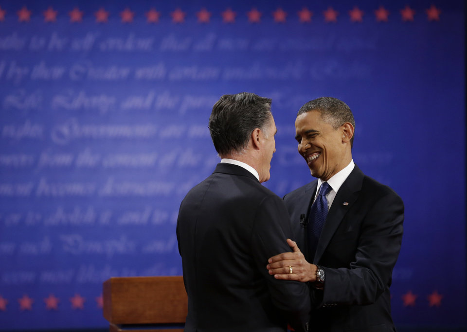 President Barack Obama, right, greets Republican presidential nominee Mitt Romney during the first presidential debate at the University of Denver, Wednesday, Oct. 3, 2012, in Denver. (AP Photo/David Goldman)