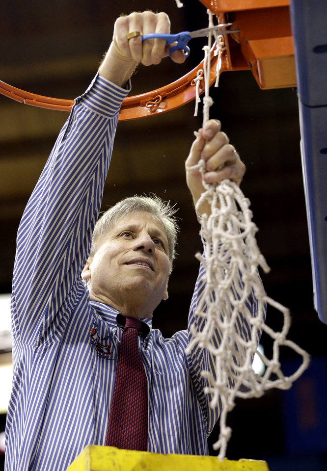 Photo - DePaul head coach Doug Bruno cuts down the net after defeating St. John's 65-57 during an NCAA college basketball game in the final of the 2014 Big East women's basketball tournament in Rosemont, Ill., Tuesday, March 11, 2014. (AP Photo/Nam Y. Huh)
