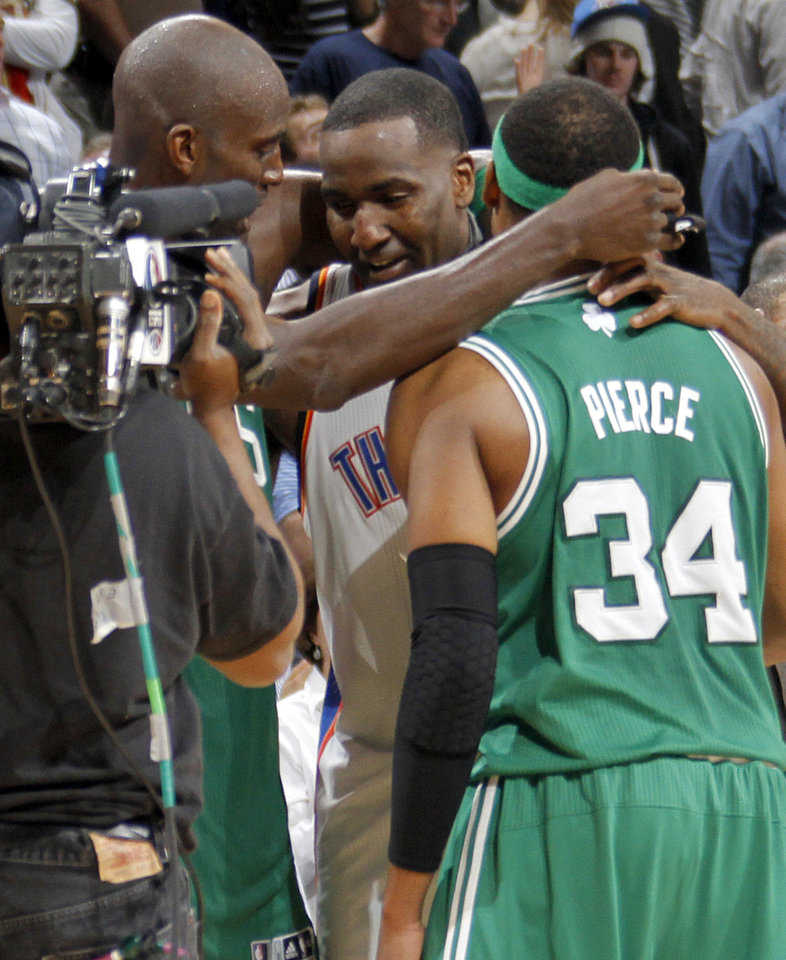 Oklahoma City Thunder center Kendrick Perkins (5) hugs Boston Celtics power forward Kevin Garnett (5) and Boston Celtics small forward Paul Pierce (34) after the Thunder\'s win over Boston during the NBA basketball game between the Oklahoma City Thunder and the Boston Celtics at the Chesapeake Energy Arena on Wednesday, Feb. 22, 2012 in Oklahoma City, Okla. Photo by Chris Landsberger, The Oklahoman