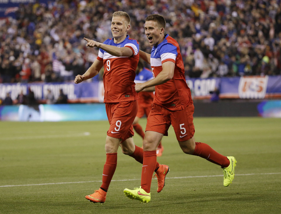 Photo - United States' Aron Johannsson (9) celebrates his goal with teammate Matt Besler, right, during the second half of an international friendly soccer match against Azerbaijan on Tuesday, May 27, 2014, in San Francisco. United States won 2-0. (AP Photo/Marcio Jose Sanchez)