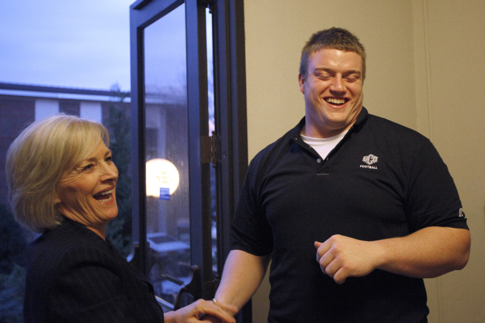 UCO football Sam Moses and Nancy Busby, executive assistant to the president laugh as they practice for a dancing fundraiser at Evans Hall on the campus of the University of Central Oklahoma in Edmond, Okla., Thursday, Feb. 2, 2012. Photo by Sarah Phipps, The Oklahoman