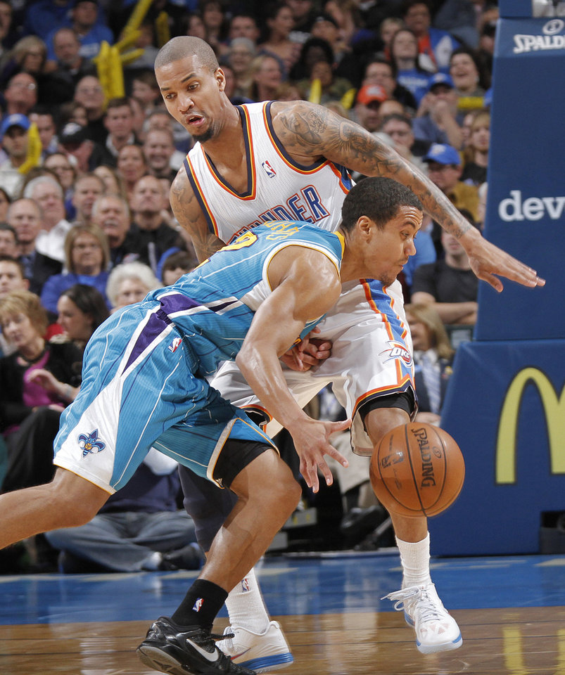 Photo - Oklahoma City Thunder's Eric Maynor (6) defends on New Orleans Hornets' Brian Roberts (22) during the NBA basketball game between the Oklahoma CIty Thunder and the New Orleans Hornets at the Chesapeake Energy Arena on Wednesday, Dec. 12, 2012, in Oklahoma City, Okla.   Photo by Chris Landsberger, The Oklahoman