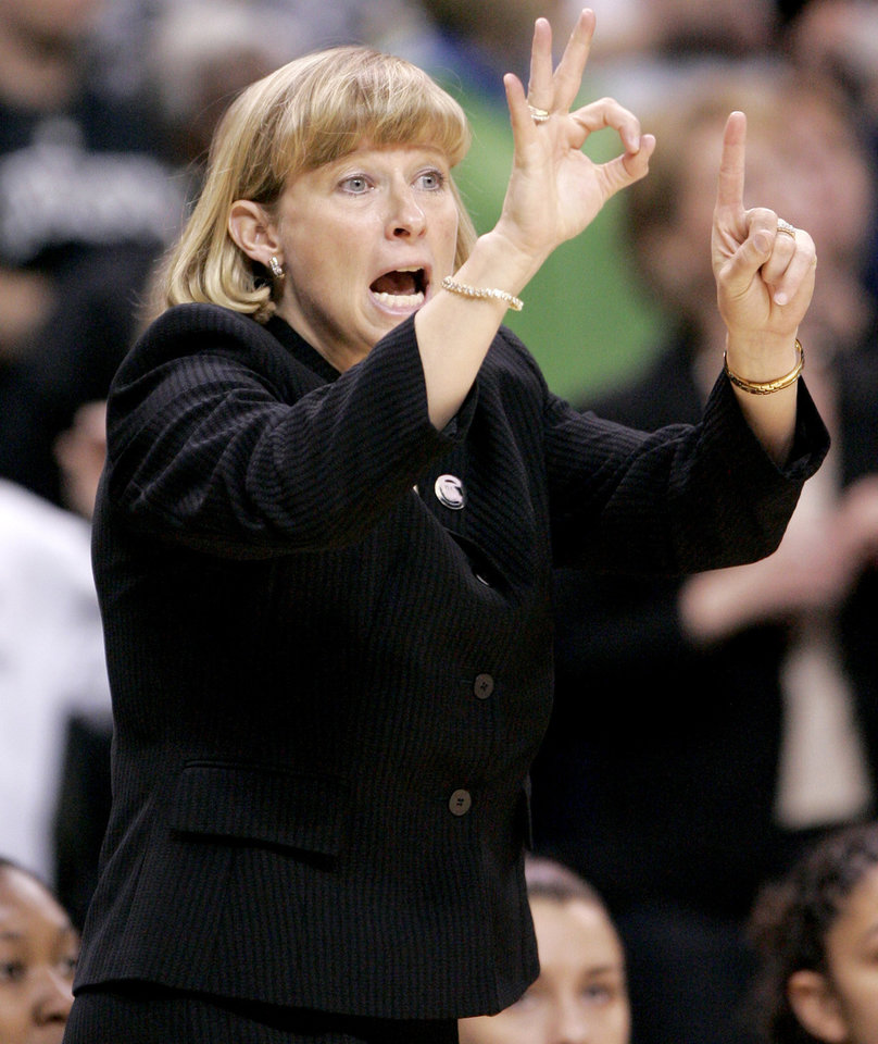 Photo - Purdue coach Sharon Versyp shouts at her team during the NCAA women's basketball regional  tournament finals between Oklahoma and Purdue at the Ford Center in Oklahoma City, Tuesday, March 31, 2009.  OU won, 74-68. Photo by Bryan Terry, The Oklahoman