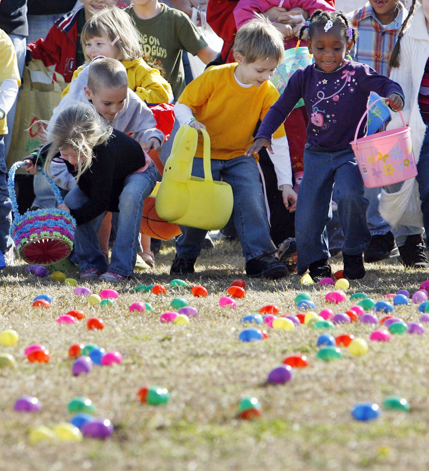 Children race to pick up plastic eggs during OKC Egg Drop, Northview Community Church's Easter egg hunt, at Harvest Hills Park in Oklahoma City, Saturday, April 11, 2009. Photo by Nate Billings, The Oklahoman