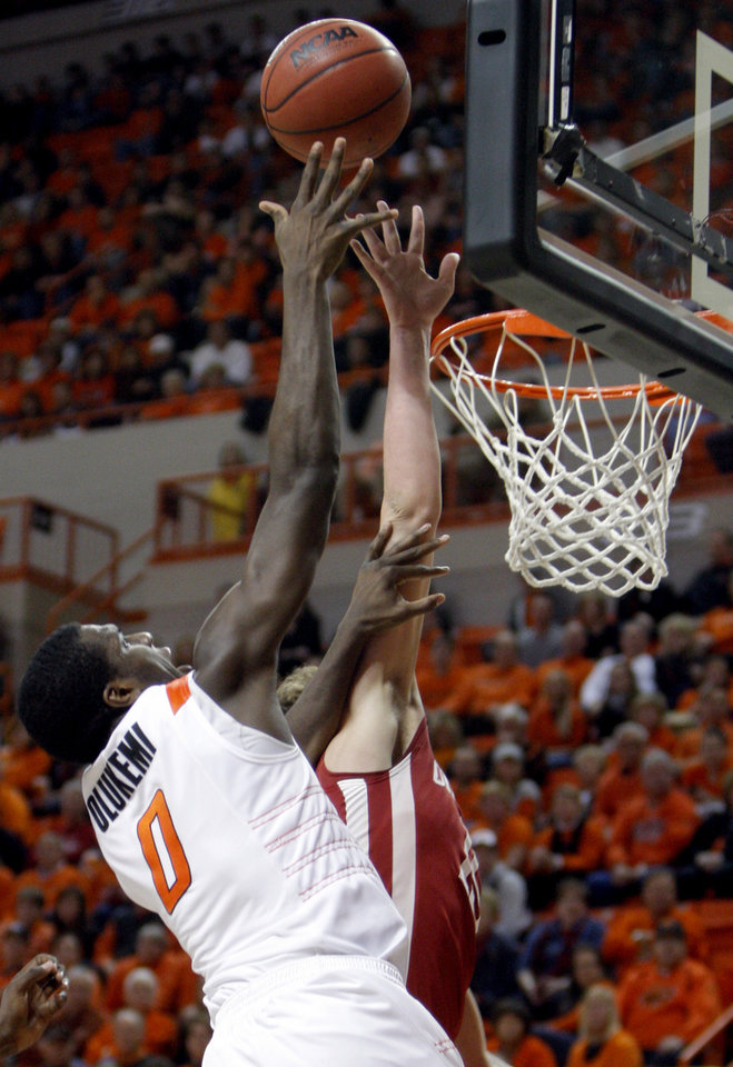 Oklahoma State's Jean-Paul Olukemi (0) shoots over Oklahoma's Tyler Neal (15)during the Bedlam men's college basketball game between the University of Oklahoma Sooners and Oklahoma State University Cowboys at Gallagher-Iba Arena in Stillwater, Okla., Saturday, February, 5, 2011. Photo by Sarah Phipps, The Oklahoman