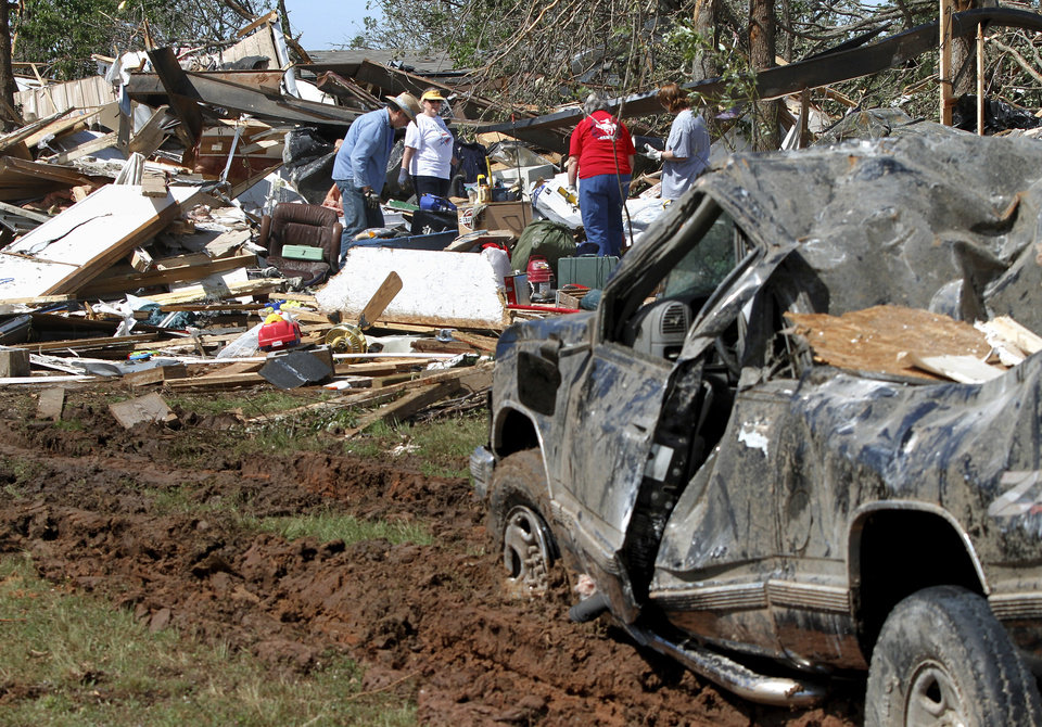 Photo - Friends and family salvage items from the destroyed home of John and Barbara DeCouser in Steelman Estates in Bethel Acres on Wednesday, May 22, 2013. Photo  by Jim Beckel, The Oklahoman.