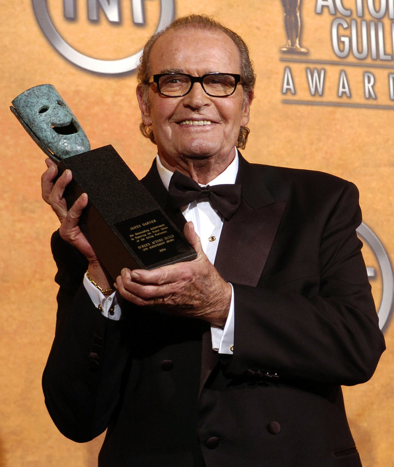 Photo - FILE - James Garner holds the 41st annual life achievement award backstage at the 11th annual Screen Actors Guild Awards in this Saturday, Feb. 5, 2005 file photo taken in Los Angeles. (AP Photo/Chris Pizzello, File)