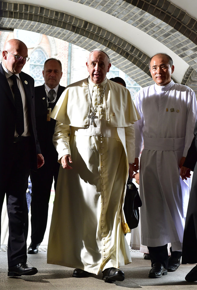 Photo - Pope Francis, center, arrives to meet with South Korea's religious leaders at Myeong-dong Cathedral in Seoul, South Korea, on Monday, Aug. 18, 2014. (AP Photo/Jung Yeon-je, Pool)
