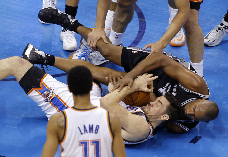 Photo - Oklahoma City's Nick Collison (4) and San Antonio's Boris Diaw (33) fight for a loose ball during Game 4 of the Western Conference Finals in the NBA playoffs between the Oklahoma City Thunder and the San Antonio Spurs at Chesapeake Energy Arena in Oklahoma City, Tuesday, May 27, 2014. Photo by Bryan Terry, The Oklahoman