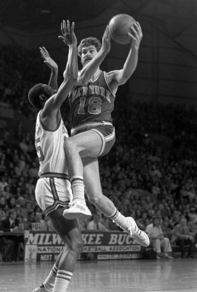 Photo - FILE - In this Dec. 29, 1974 file photo, New York Knicks' Phil Jackson (18) goes to the basket against Milwaukee Bucks' Cornell Warner during an NBA basketball game in Milwaukee. Carmelo Anthony says he has heard that 11-time NBA champion coach Phil Jackson will be