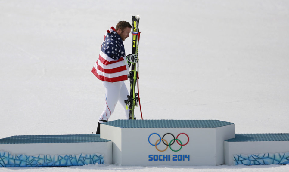 Photo - United States' Bode Miller walks to the podium after winning the joint bronze medal in the men's super-G at the Sochi 2014 Winter Olympics, Sunday, Feb. 16, 2014, in Krasnaya Polyana, Russia. (AP Photo/Gero Breloer)