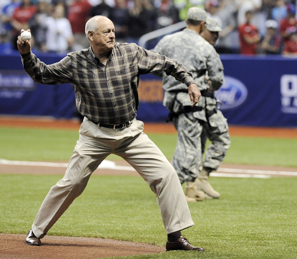 Texas Rangers president and CEO Nolan Ryan throws the ceremonial first pitch before an exhibition baseball game between the San Diego Padres and the Rangers, Saturday, March 30, 2013, in San Antonio. (AP Photo/Darren Abate)