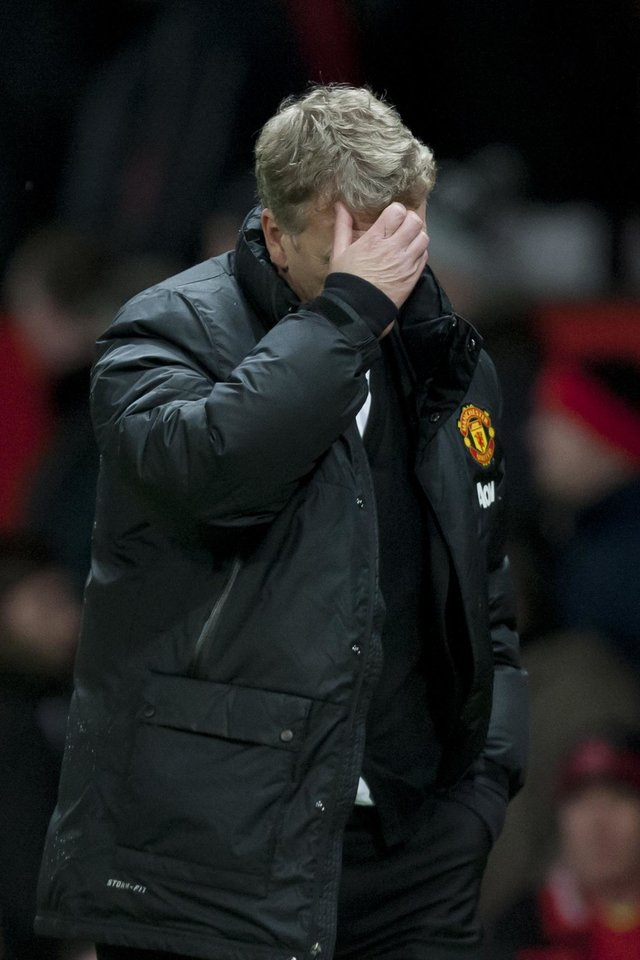 Photo - Manchester United's manager David Moyes walks from the pitch after his team's 2-1 loss to Swansea City in their English FA Cup third round soccer match at Old Trafford Stadium, Manchester, England, Sunday, Jan. 5, 2014. (AP Photo/Jon Super)