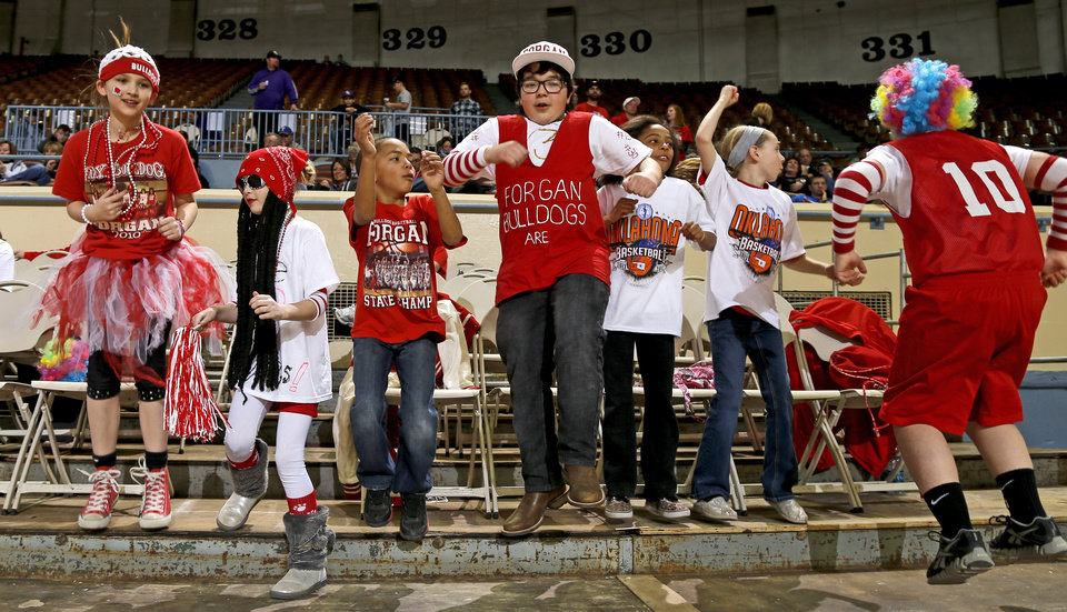 Photo - Forgan fans cheer before a Class B Boys game of the state high school basketball tournament between Forgan and Coyle at the State Fair Arena at State Fair Park in Oklahoma City, Thursday, Feb. 28, 2013. Photo by Bryan Terry, The Oklahoman