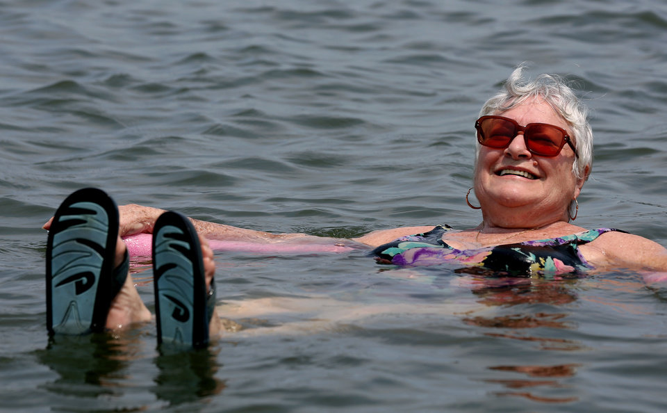 Photo -   Lillian Mariscalo of Oyster Bay, N.Y. cools off in the waters of an Oyster Bay beach on Long Island's North shore Saturday, July 7, 2012. The heat gripping much of the country was set to peak Saturday in several places, with temperatures of more than 100 degrees expected in Philadelphia, excessive heat warnings in the Midwest and ongoing power outages of more than a week in the mid-Atlantic. (AP Photo/Craig Ruttle)