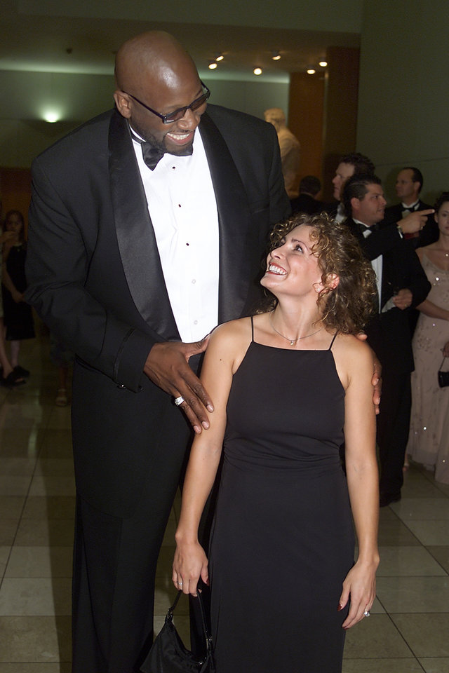INDUCT, INDUCTEE, INDUCTEES: Wayman Tisdale and Shannon Miller meet at a reception before their induction ceremony into the Oklahoma Sports Hall of Fame at the National Cowboy and Western Heritage Museum. Staff photo by Paul Hellstern