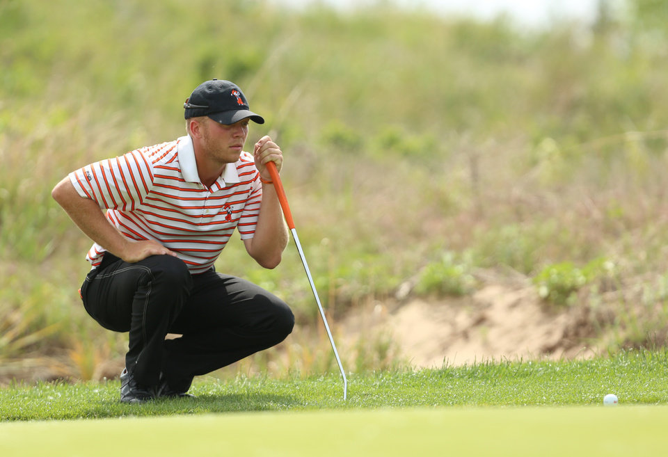 Photo - Oklahoma State's Talor Gooch lines up his putt on the eighth green during the semifinals of team match play of the NCAA men's golf championship Tuesday, May 27, 2014, at Prairie Dunes Country Club in Hutchinson, Kan. Gooch won the match against Stanford's Maverick McNealy on the third extra hole. (AP Photo/The Hutchinson News, Travis Morisse)
