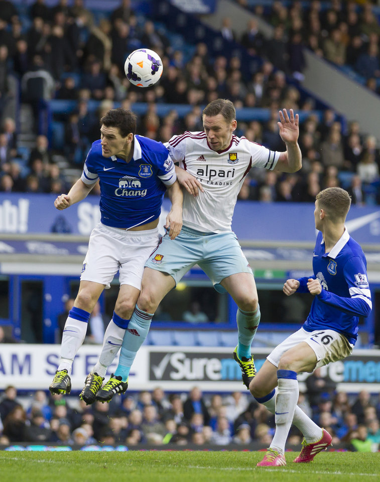 Photo - Everton's Gareth Barry, left, fights for the ball against West Ham United's Kevin Nolan during their English Premier League soccer match at Goodison Park Stadium, Liverpool, England, Saturday March 1, 2014. (AP Photo/Jon Super)