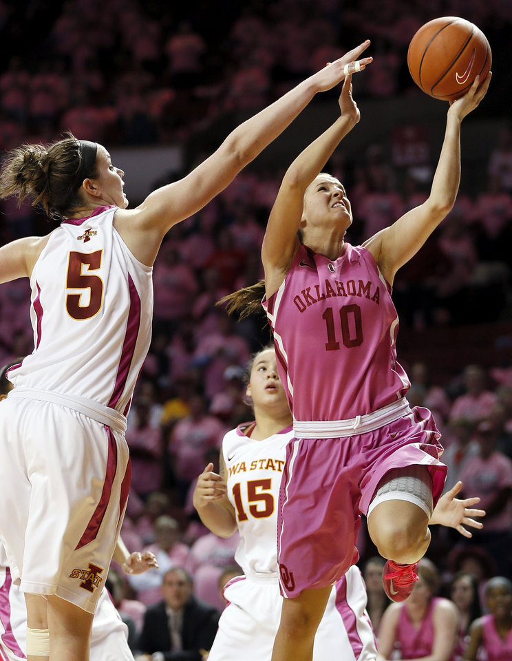 Photo - Oklahoma's Morgan Hook (10) takes the ball to the hoop past Iowa State's Hallie Christofferson (5) and Nicole
