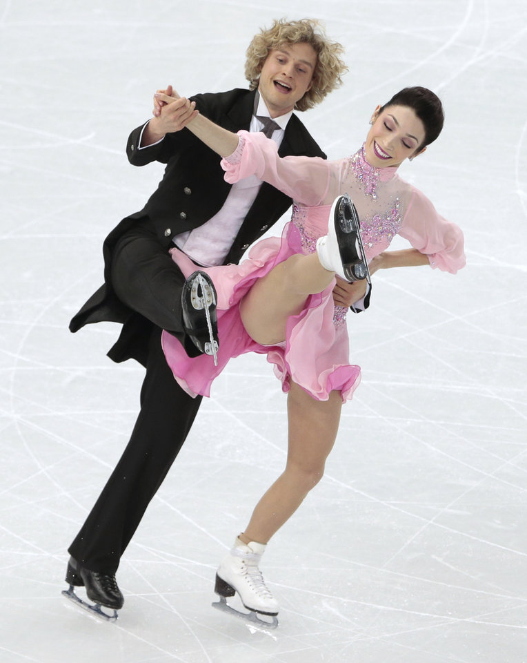 Photo - Meryl Davis and Charlie White of the United States compete in the ice dance short dance figure skating competition at the Iceberg Skating Palace during the 2014 Winter Olympics, Sunday, Feb. 16, 2014, in Sochi, Russia. (AP Photo/Ivan Sekretarev)
