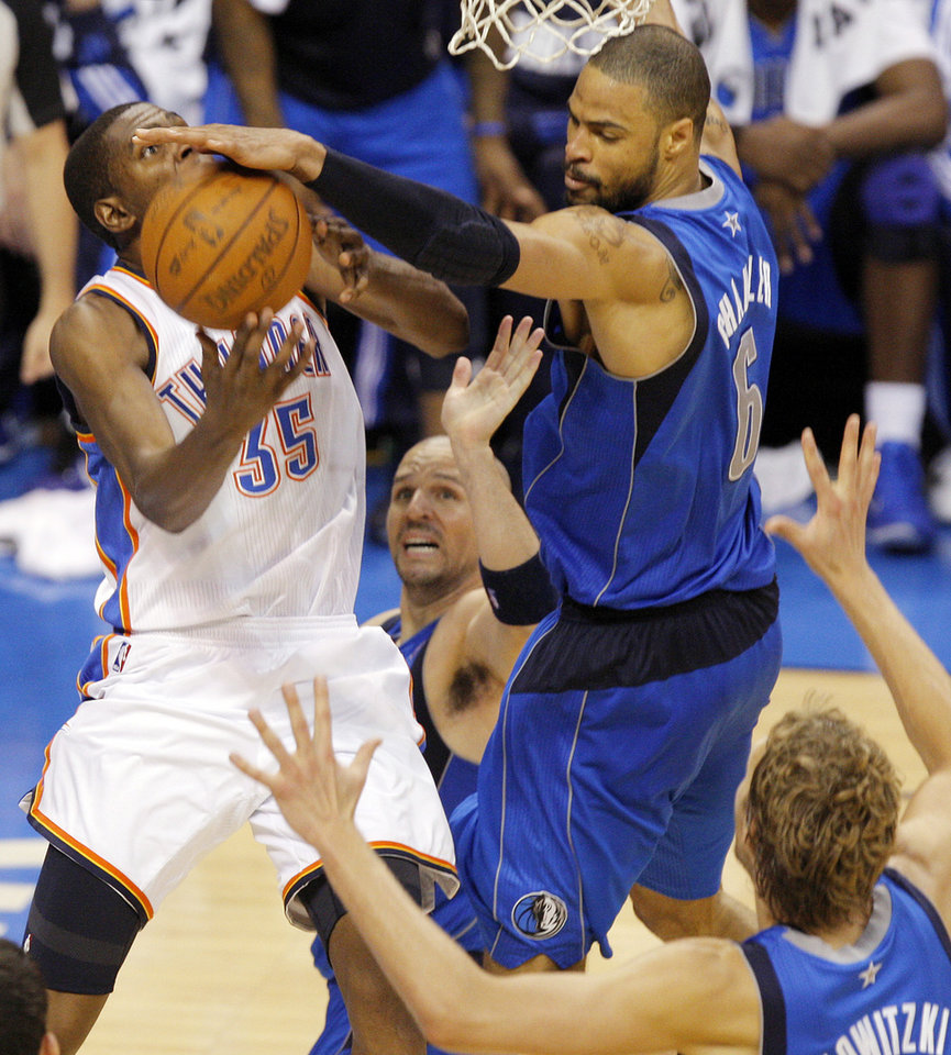 Tyson Chandler (6) of Dallas blocks a shot by Kevin Durant (35) of Oklahoma City near Jason Kidd (2) and Dirk Nowitzki (41) of Dallas in the second half during game 3 of the Western Conference Finals of the NBA basketball playoffs between the Dallas Mavericks and the Oklahoma City Thunder at the OKC Arena in downtown Oklahoma City, Saturday, May 21, 2011. Dallas won, 93-87. Photo by Nate Billings, The Oklahoman