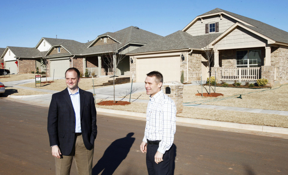 Steve Shoemaker, Ideal Homes director of marketing, and Vernon McKown, co-owner and president of sales, show homes that the company is building in the 11400 Block of NW 131 in the Buffalo Grove area of the Village Verde addition in northwest Oklahoma City, near Piedmont.