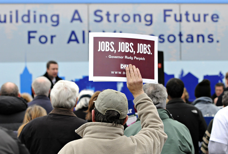 Supporters hold signs during a rally for Democratic Party candidates at River's Edge Convention Center in St. Cloud, Minn., Saturday, Nov. 3, 2012. (AP Photo/The St. Cloud Times, Dave Schwarz) NO SALES