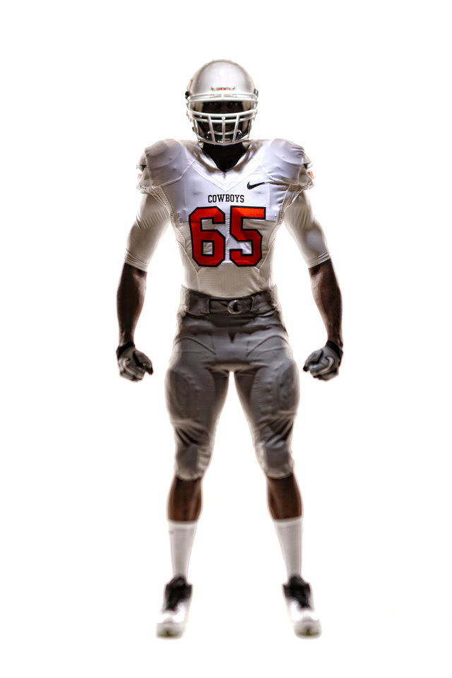 Oklahoma State\'s new football uniforms. Pictured here are the white jersey, silver pants and the white helmet. PHOTO PROVIDED