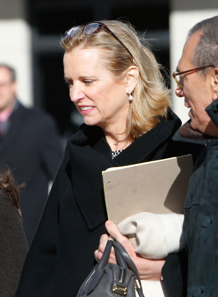 Photo - Kerry Kennedy arrives at the Westchester County Courthouse prior to her acquittal in her drugged-driving  case, Friday, Feb. 28, 2014. Kennedy was acquitted Friday of drugged driving after she accidentally took a sleeping pill and then sideswiped a truck in a wild highway drive in July, 2012, she said she didn't remember. (AP Photo/The Journal News, Tania Savayan)