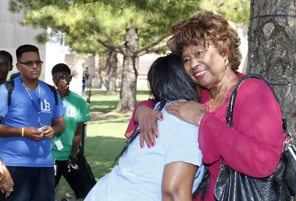 Photo - Jannie Covedale, right, who lost two grandchildren in the Oklahoma City bombing, hugs Courtney Jackson, left, a student from Tarrant County College, in Ft. Worth Texas, at the Oklahoma City Bombing Memorial in Oklahoma City, Friday, July 25, 2014. Coverdale stopped to talk with a group of students who recognized her after viewing exhibits in the Oklahoma City Bombing Museum. Coverdale said she is hopeful that an upcoming trial in Utah will shed light on the bombing. (AP Photo/Sue Ogrocki)