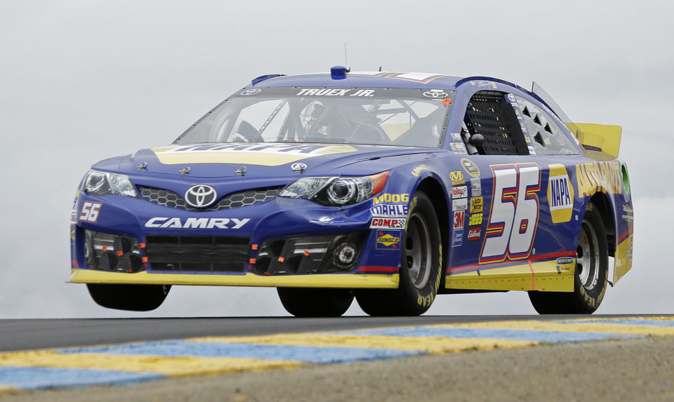 Martin Truex Jr. races in the NASCAR Sprint Cup series auto race, Sunday, June 23, 2013, in Sonoma, Calif. (AP Photo/Eric Risberg)