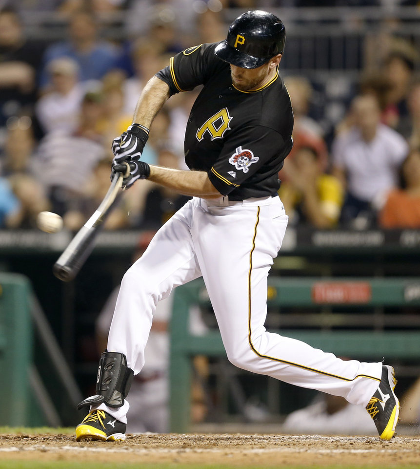 Photo - Pittsburgh Pirates' Ike Davis hits a single to right field to drive in the game winning run against the Arizona Diamondbacks in the ninth inning of the baseball game on Tuesday, July 1, 2014, in Pittsburgh. The Pirates scored three runs in the bottom of the ninth inning to win 3-2. (AP Photo/Keith Srakocic)