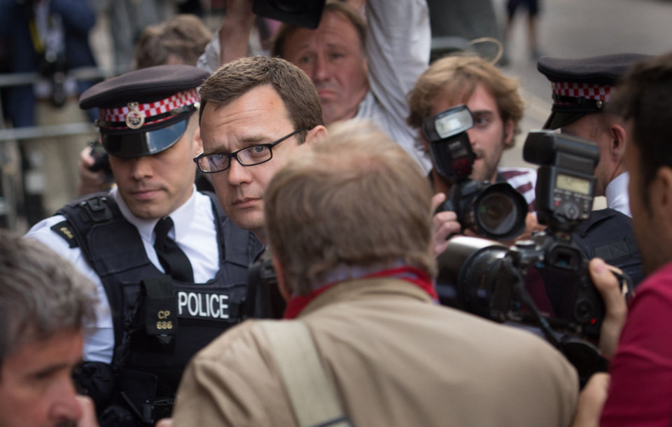 Photo - Former News of the World editor Andy Coulson, centre,  arrives at the Old Bailey court to receive his sentence,  in London,  Friday, July 4, 2014. Coulson, a onetime aide to British Prime Minister David Cameron, was sentenced to 18 months in jail Friday for participating in a conspiracy to hack the phones of celebrities, politicians and crime victims. (AP Photo/PA, Stefan Rousseau) UNITED KINGDOM OUT