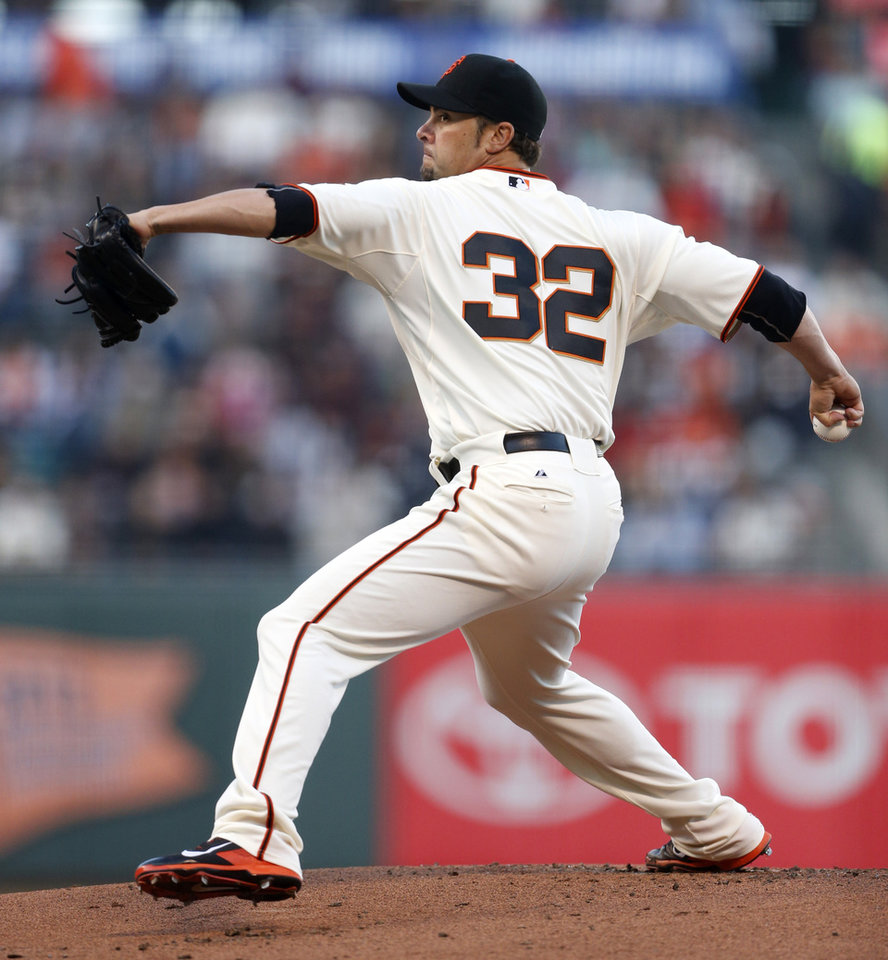 Photo - San Francisco Giants pitcher Ryan Vogelsong winds up during the first inning of a baseball game against the Washington Nationals, Monday, June 9, 2014, in San Francisco, Calif. (AP Photo/Beck Diefenbach)