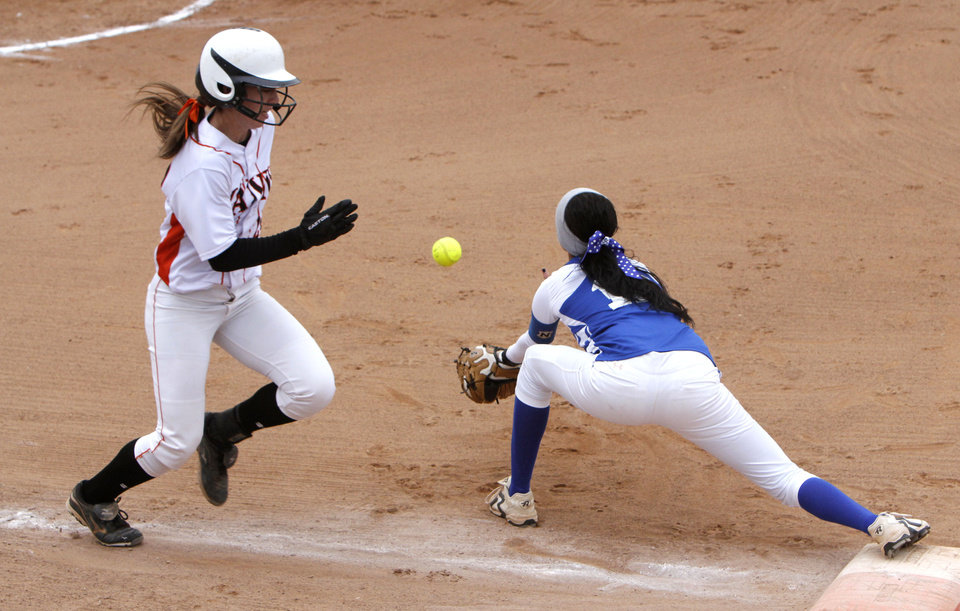 Wayne\'s Casey Redus is put out at first base by Cyril-Cement\'s Chandler Pinkley during the class 2A Girl\'s State Softball playoffs at the ASA Hall of Fame Stadium in Oklahoma City, OK, Friday, October 5, 2012, By Paul Hellstern, The Oklahoman