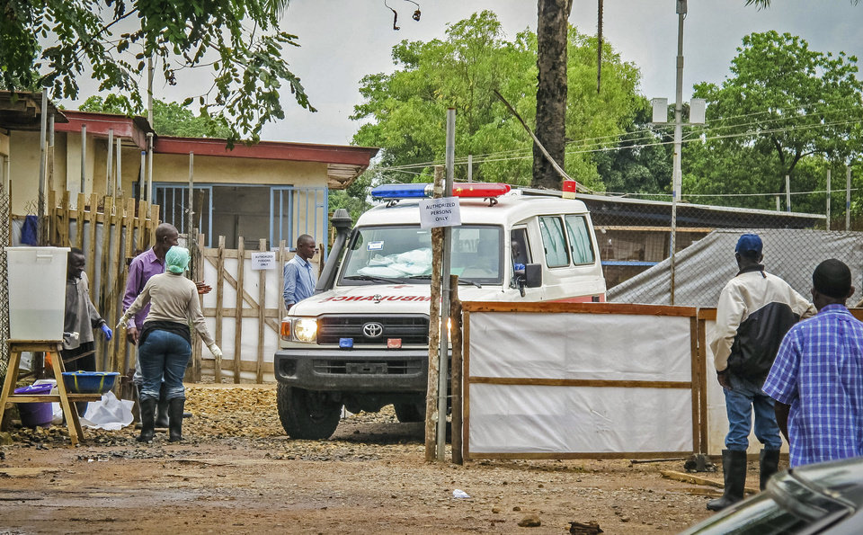 Photo - In this photo taken Sunday, Aug. 10, 2014,  an ambulance leaves the Ebola isolation unit carrying the bodies of Ebola victims that are highly contagious to a burial site, at the Kenema Government Hospital situated in the Eastern Province around 300 km, (186 miles), from the capital city of Freetown in Kenema, Sierra Leone.  Over the decades, Ebola cases have been confirmed in 10 African countries, including Congo where the disease was first reported in 1976. But until this year, Ebola had never come to West Africa.  (AP Photo/ Michael Duff)