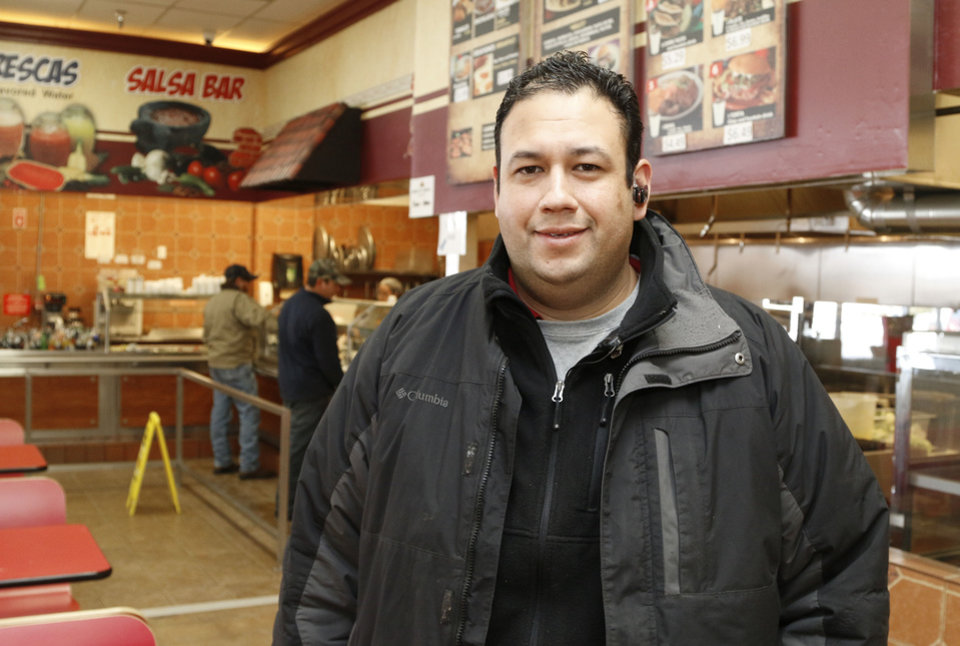 Photo - Jose Ibarra Jr. is the manager of Supermercado Morelos on Feb. 6 in Moore.  Photo by Paul Hellstern, The Oklahoman  PAUL HELLSTERN - Oklahoman
