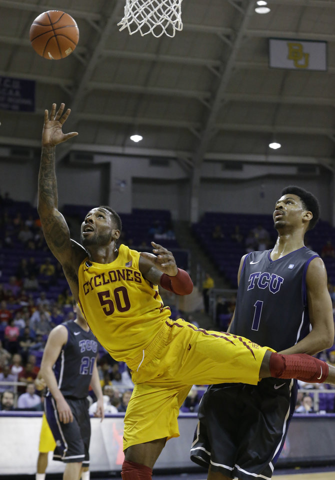 Photo - Iowa State guard DeAndre Kane (50) shoots past TCU center Karviar Shepherd (1) during the first half of an NCAA college basketball game Saturday, Feb. 22, 2014, in Fort Worth, Texas. (AP Photo/LM Otero)