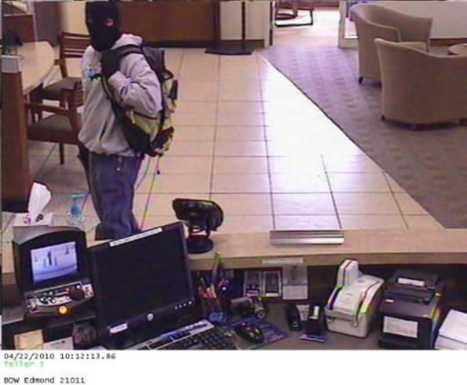 Photo - Surveillance photo of a man officials believe robbed  Bank of the  West in Edmond on Thursday morning. The FBI believes he is responsible for five  robberies in the metro area.