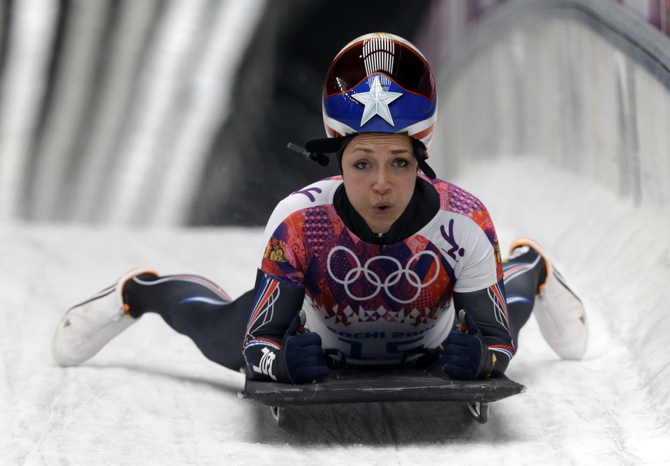 Photo - Katie Uhlaender of the United States brakes after her final run during the women's skeleton competition at the 2014 Winter Olympics, Friday, Feb. 14, 2014, in Krasnaya Polyana, Russia. (AP Photo/Dita Alangkara)