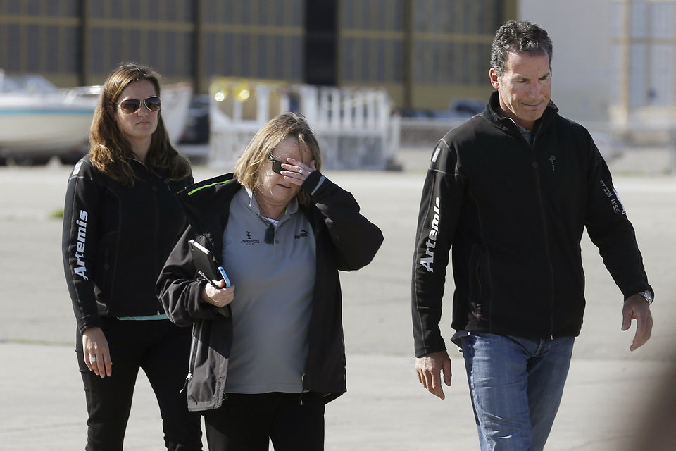 Photo - Artemis Racing CEO Paul Cayard, right, walks with Jane Eagleson, America's Cup director of Live Entertainment and Event Media, to a news conference in Alameda, Calif., Thursday, May 9, 2013. Artemis Racing said Andrew