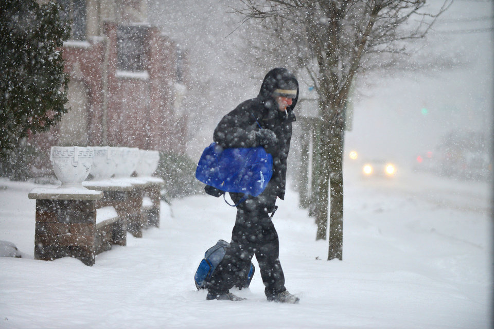 Photo - An unidentified man walks in winter condition on Anderson Aveue in Cliffside Park, N.J., on Tuesday, Jan. 21, 2014. (AP Photo/Northjersey.com, Marko Georgiev) ONLINE OUT; MAGS OUT; TV OUT; INTERNET OUT;  NO ARCHIVING; MANDATORY CREDIT