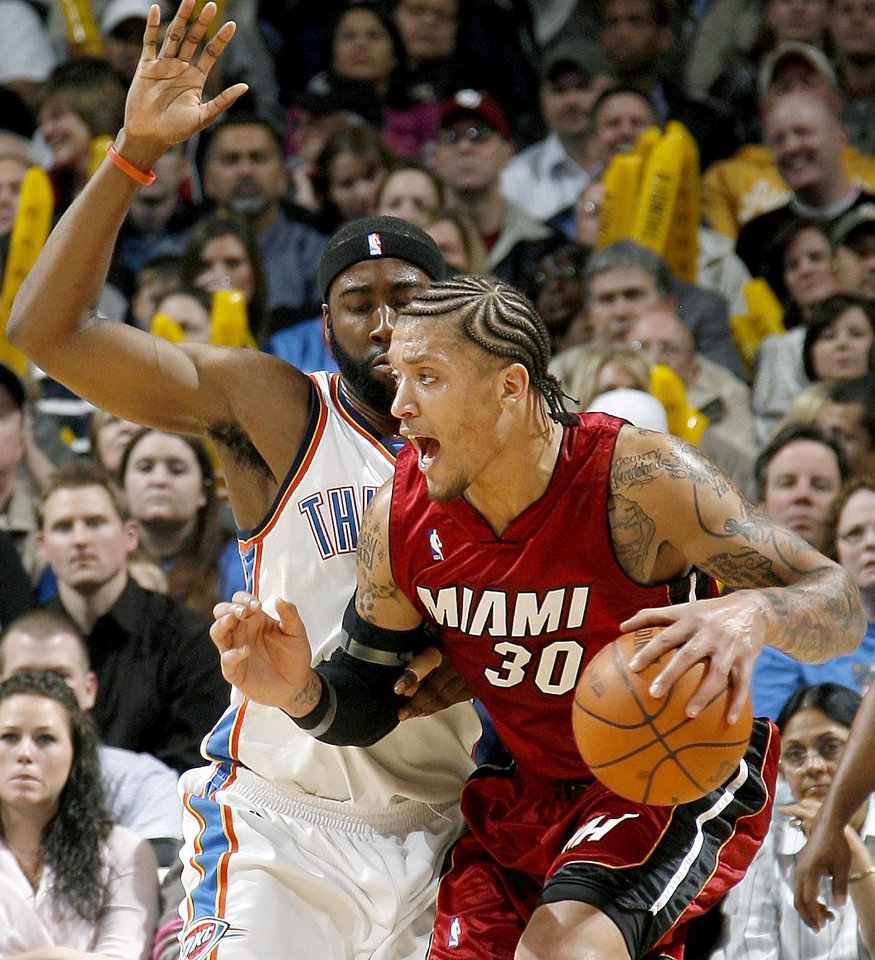 Photo - Oklahoma City's James Harden defemds Miami's Michael Beasley during the NBA basketball game between the Oklahoma City Thunder and the Miami Heat at the Ford Center in Oklahoma City, Saturday, January 16, 2010. Photo by Bryan Terry, The Oklahoman